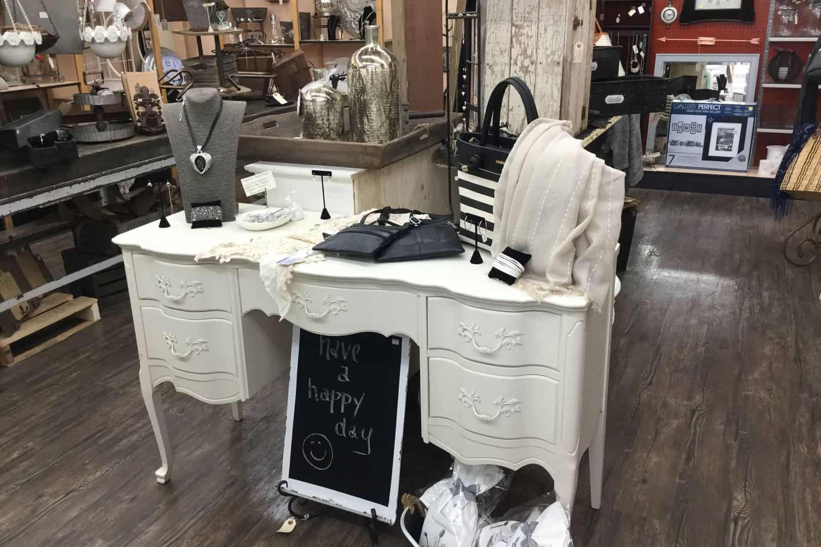 White table with clothes and jewelleries in the shop Finders to Keepers