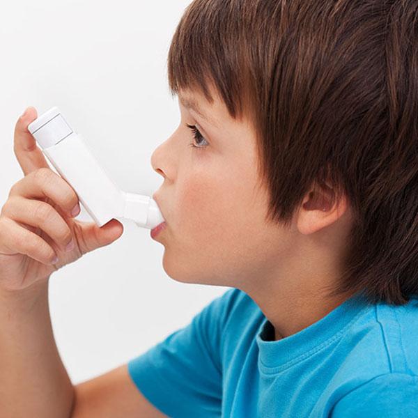 A child with an inhaler